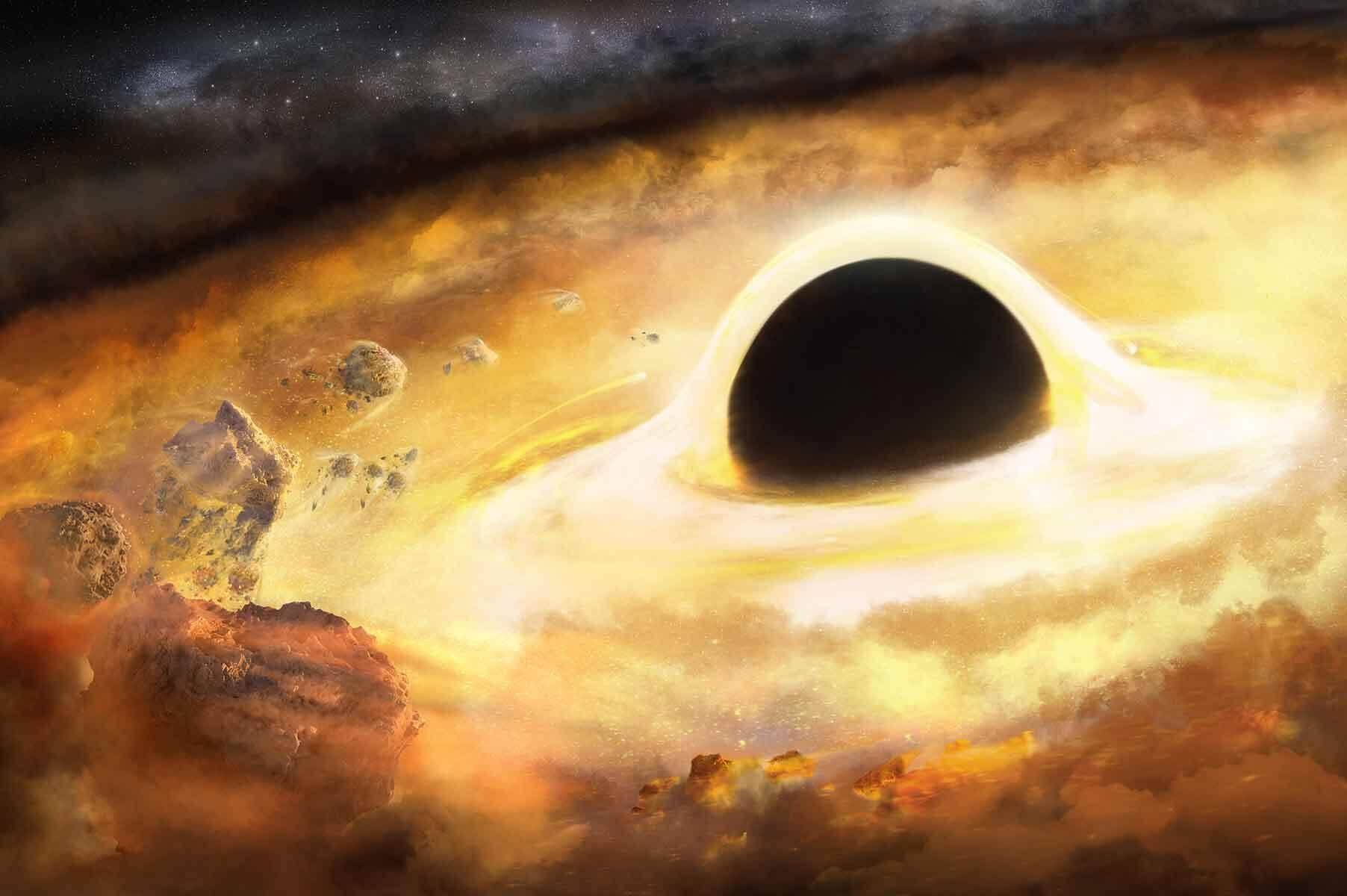 Black hole image with very bright yellow event horizon surrounding it.