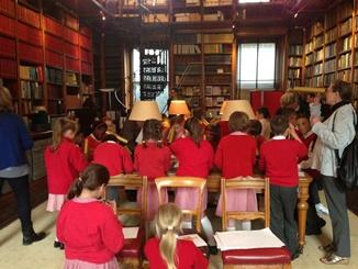 A picture showing school children during a session in the RAS library