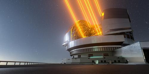 A very large ground-based telescope with observatory opened and using four laser guides.