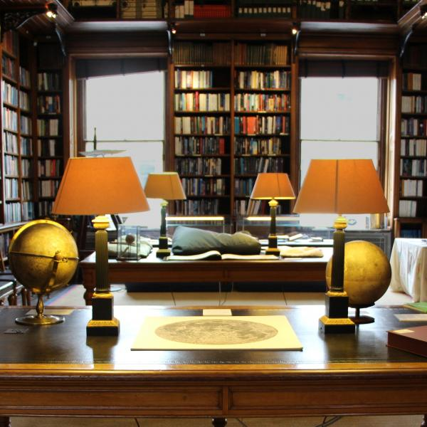 Library of the Royal Astronomical Society, with Moon globes by Russell and a map of the Moon by Cassini on display.