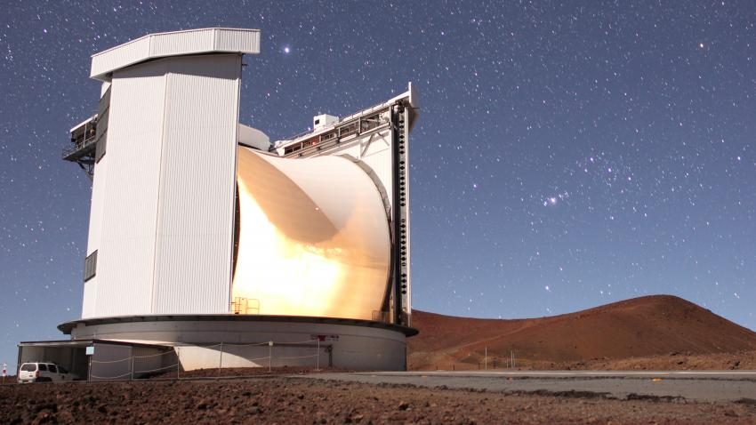 Image of the James Clerk Maxwell Telescope against a starry background
