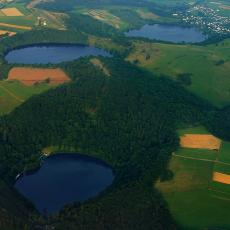 Aerial photograph of three water-filled maars in the Eifel, Germany