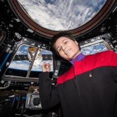 Italian ESA astronaut Samantha Cristoforetti in the Cupola on the International Space Station