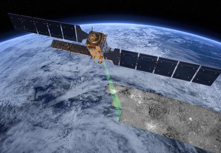 Digital rendering of the Sentinel-1 satellite in orbit, projecting a radar beam onto the Earth.