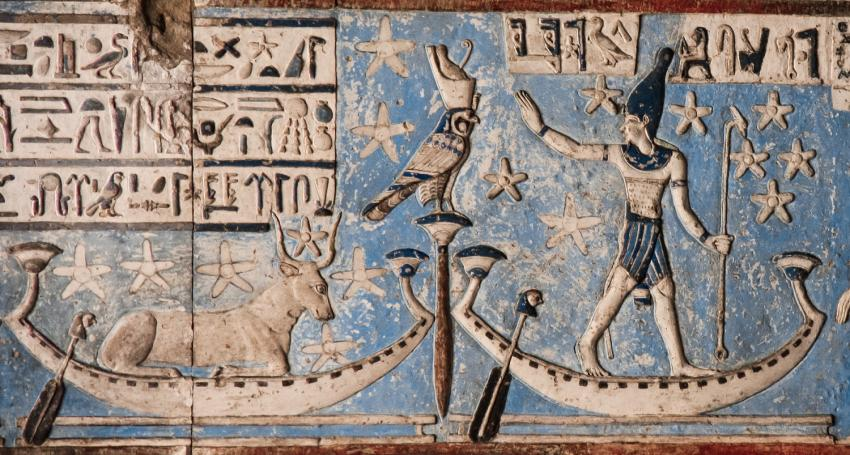 Detail from an astronomical ceiling in the temple of Dendera, depicting stars in the area of Orion (a male figure) and Sirius (a cow) sailing the sky in barques.