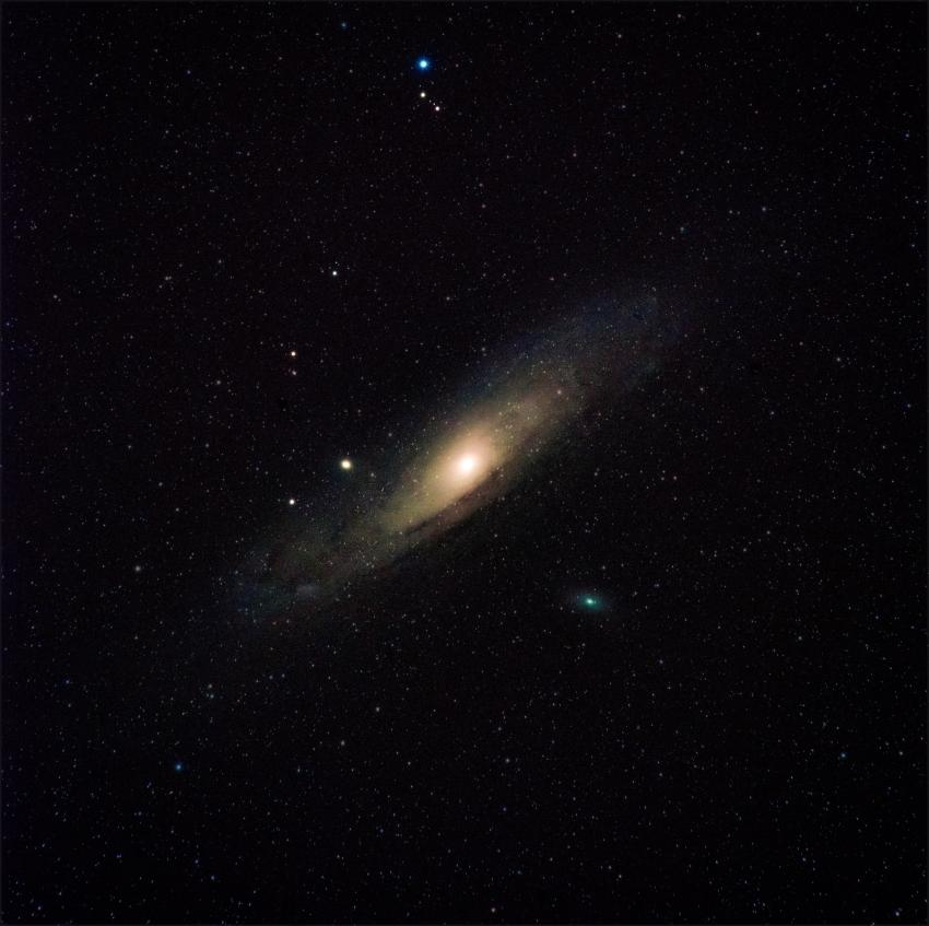 Andromeda Galaxy with a brightly illuminated centre bulge in space