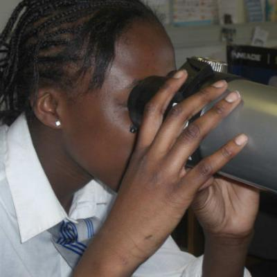A student looking through a telescope